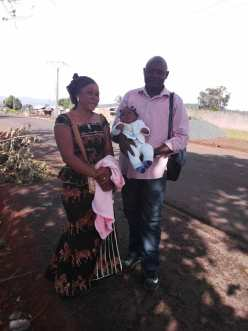 Sister Alima with Pastor Guy and the Miracle baby