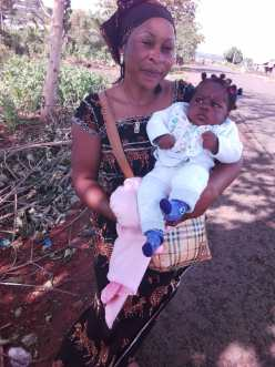 Sister Alima with her Miracle baby